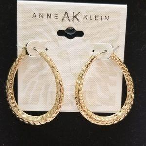 Anne Klein gold hoops.